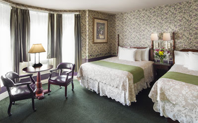 Twin beds in a traditional bedroom at the Portland, Maine hotel Inn at St. John.
