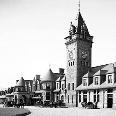 The Inn history is shown in this old black and white photo of the downtown of Portland, Maine with clock tower in the middle.