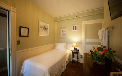 Value accommodation room with single bed.